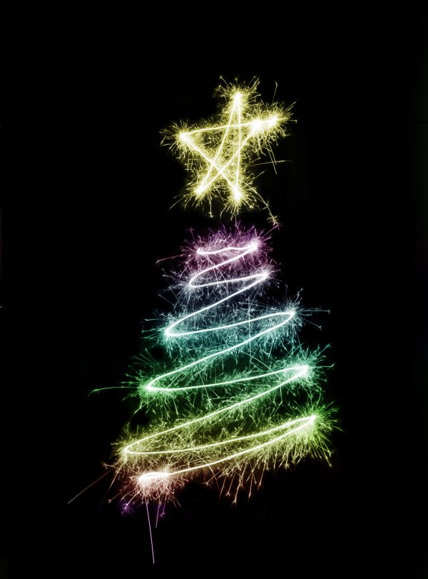 A colorful christmas tree symbol drawn with sparkler trails. Courtesy of Christmasstockimages.com